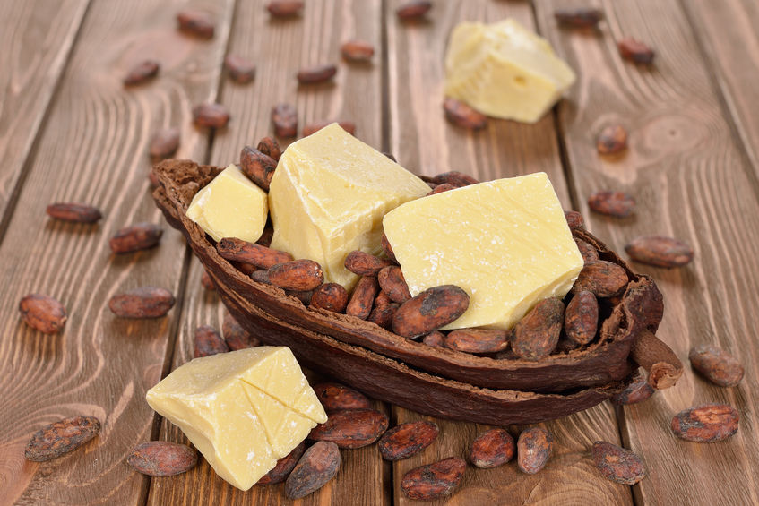 39080695 - natural cocoa butter on a brown background