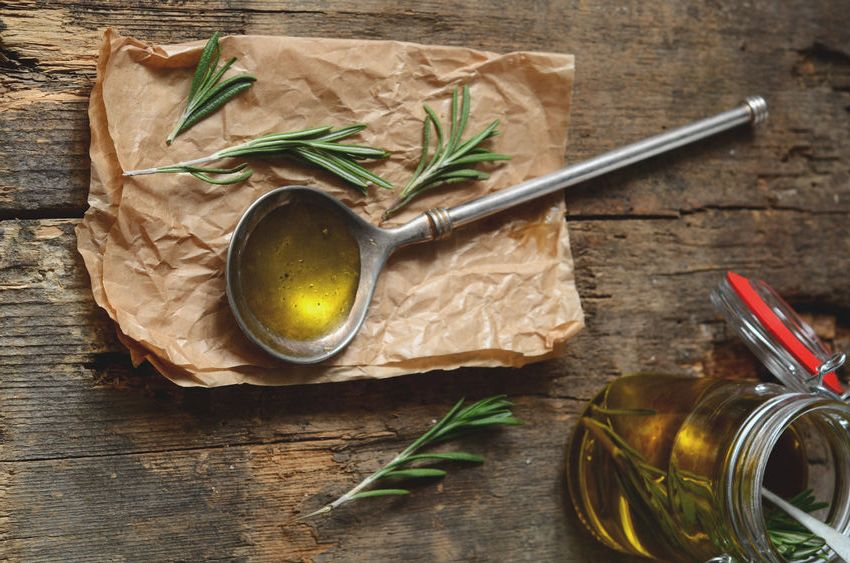 49187310 - making fragrant rosemary oil with olive oil and fresh herbs