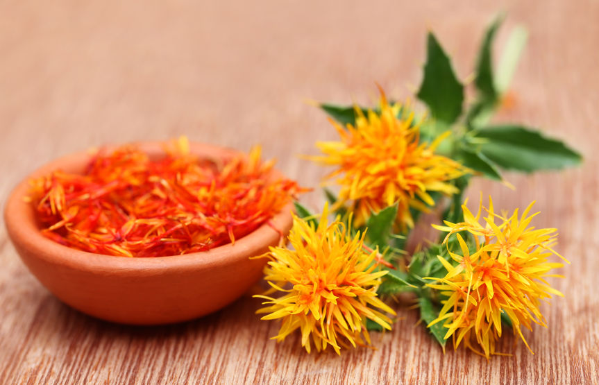 44339390 - safflower is a food additive on wooden surface